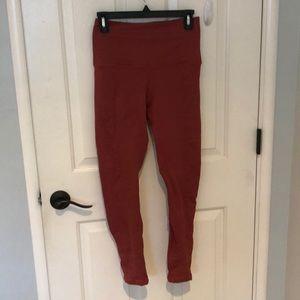 Reddish/copper leggings